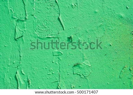 green, painted wall surface with texture