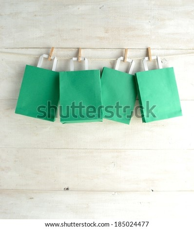 Green paper bags with clothes pins.