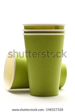 Green paper cups on white background - stock photo