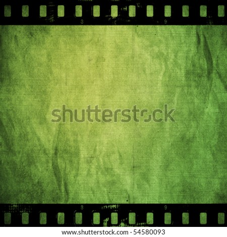 Green paper with fulm strip - stock photo