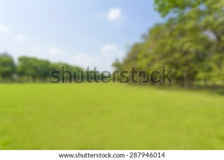 Green park and sky, blur focus - stock photo