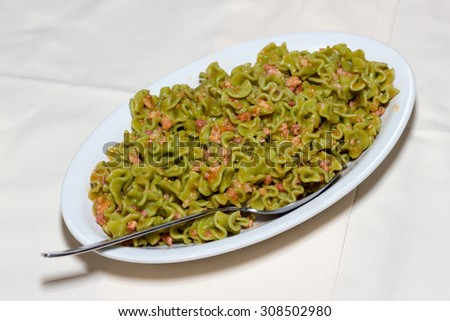 Green pasta with sausage and bacon