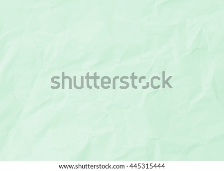 Green pastel color paper texture background. Green pastel color creased paper background texture. - stock photo
