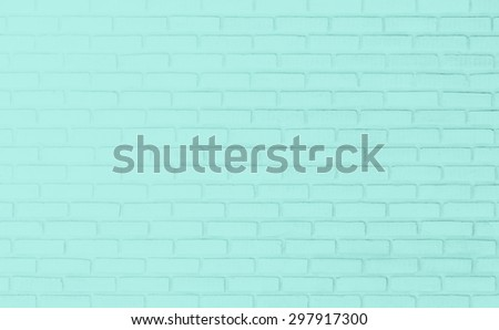 Green pastel tone brick wall background. - stock photo