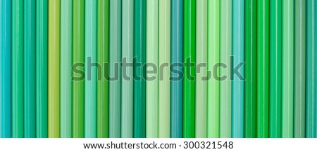 Green pastel tone of colored pencils in row. - stock photo