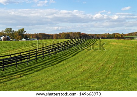 Green pastures on a farm in rural Central New Jersey. - stock photo