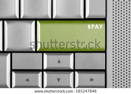 Green PAY key on a computer keyboard  - stock photo