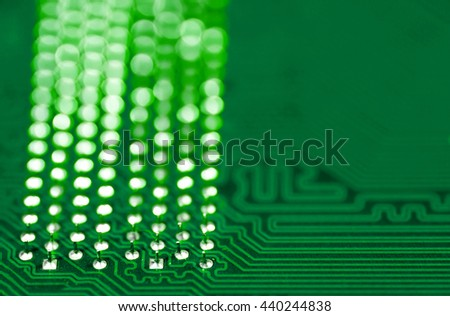 green pcb board integrated circuit pc parts motherboard chip texture background - stock photo