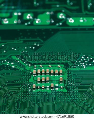 green pcb board with chip socket microchip motherboard abstract background