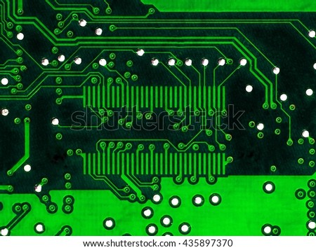 green pcb motherboard with chip microchip background  - stock photo