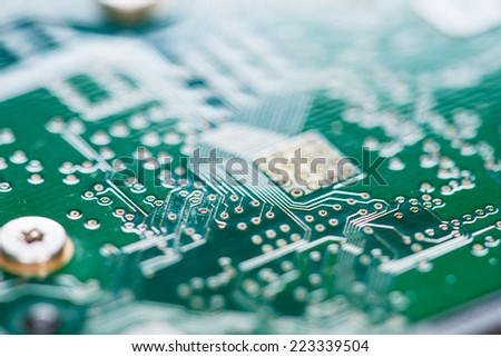 Green PCB (without components) as detailed macro shot - stock photo