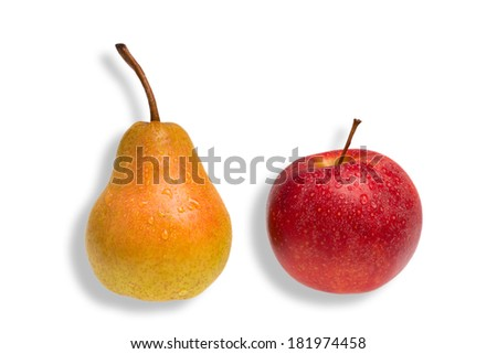green pear and red apple as a concept for comparison - stock photo