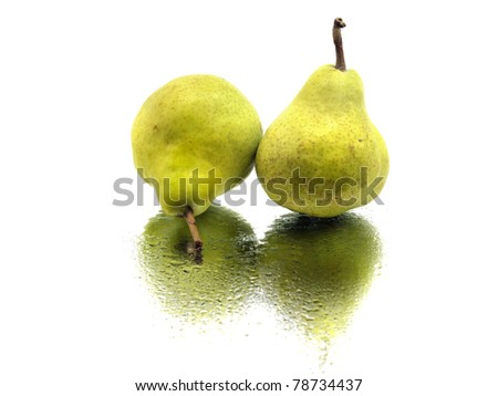 green pear on a white background with water drops