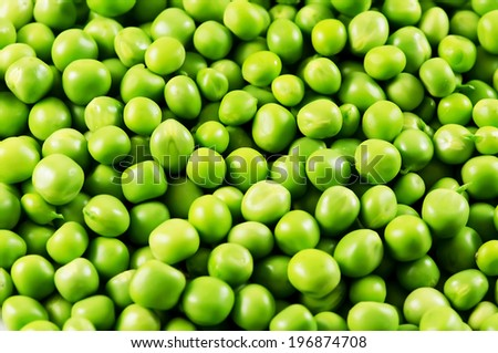 Green peas background. - stock photo
