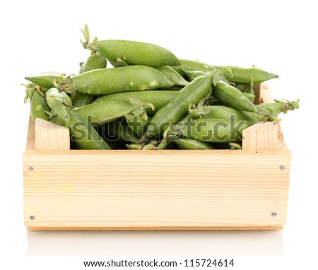 Green peas in crate isolated on white