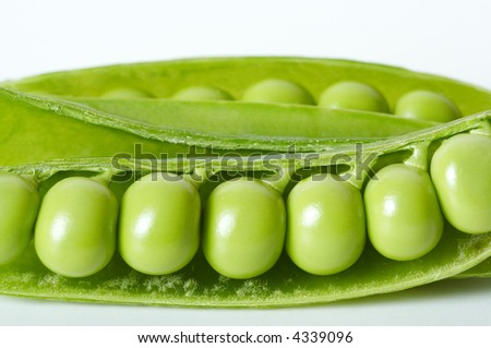 Green peas in pod close-up on white background.