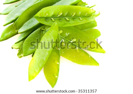 green peas in pods. isolation on white