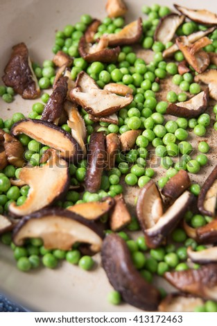 Green Peas, Mushrooms and Herbs Cooked on Skillet for Dinner