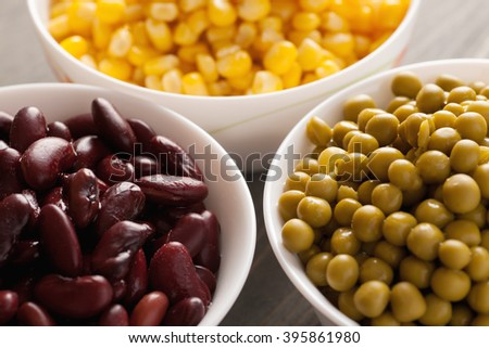 Green peas, red beans and sweet corn closeup, selective focus - stock photo