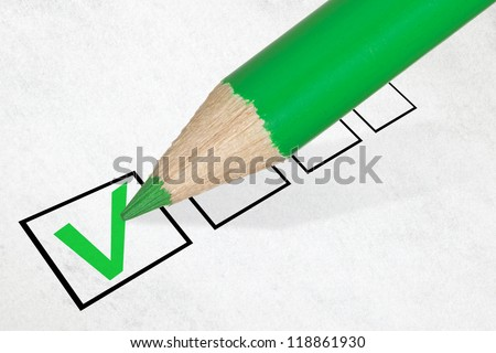 Green pencil marking check box. Concept for customer satisfaction survey or education research - stock photo