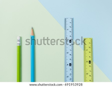 Green pencil, ruler and blue pencil