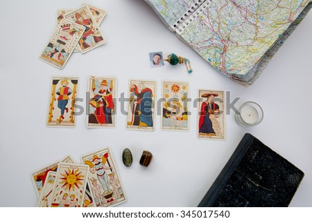 Green pendulum over a table with astrology chart and tarots cards - stock photo