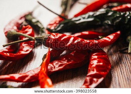 green pepper and Red peppers on  wooden table - stock photo