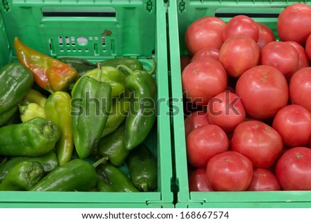 green pepper and tomatoes in green crates - stock photo