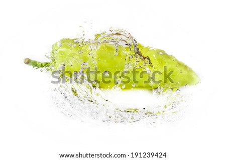 green pepper with water splash isolated on white - stock photo