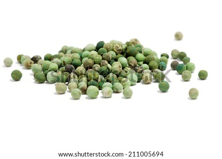 green peppercorn on white background - stock photo