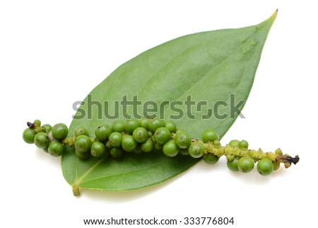 green peppercorns with leaf isolated on a white background