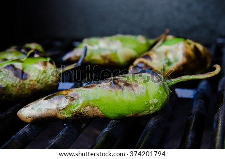 Green peppers roasting on the grill