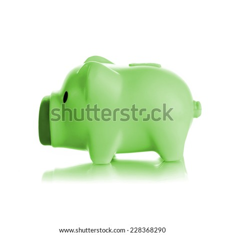 Green piggy bank on white background