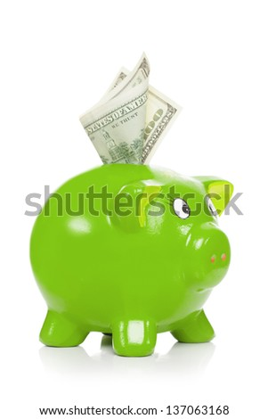 Green piggy bank with dollars sticking out - isolated on white background - stock photo
