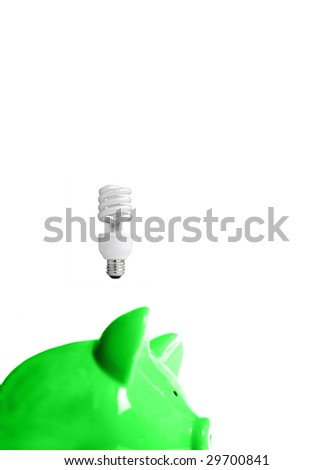 green piggy bank with energy-efficient light-bulb above (smart energy) - stock photo