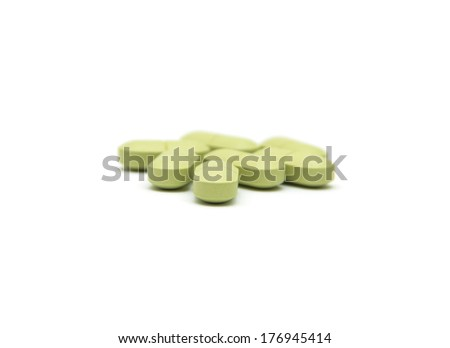 Green pills isolated on white