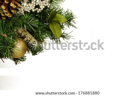 Green pine garland with Christmas decorations isolated on white background.