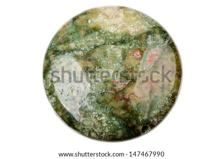 Green, pink and red flower Jasper bead in the shape of a round coin. - stock photo
