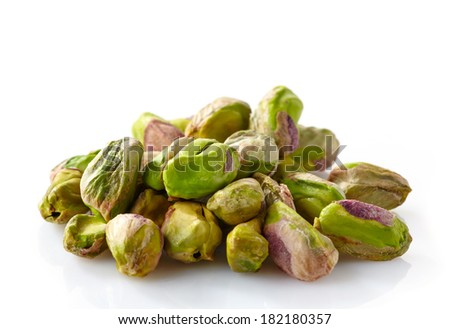 green pistachios isolated on a white background