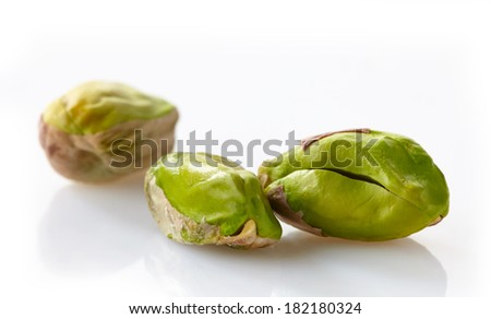 green pistachios on a white background - stock photo