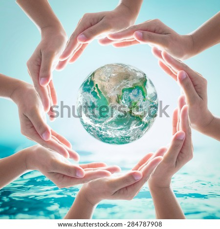 Green planet among collaborative human hands on turquoise blue water background : World ocean and nature environment concept: Healthy oceans, clean planet : Elements of this image furnished by NASA