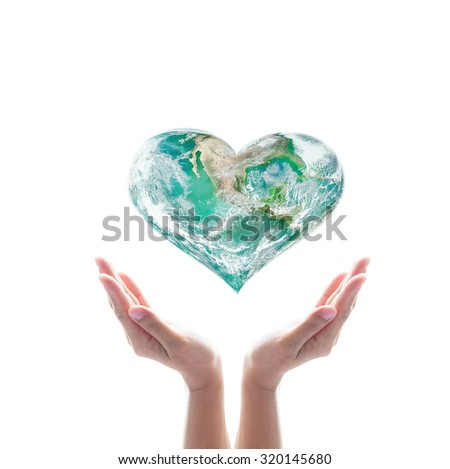 Green planet in heart shape over woman human hands isolated on white background: World heart day idea symbolic concept campaign to promote health awareness: Elements of this image furnished by NASA