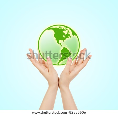 Green planet  in women's hands
