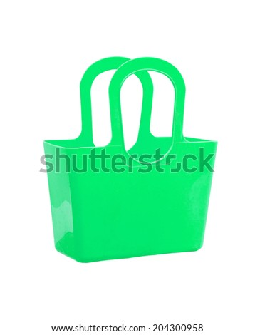 Green plastic bag isolated on white background. - stock photo