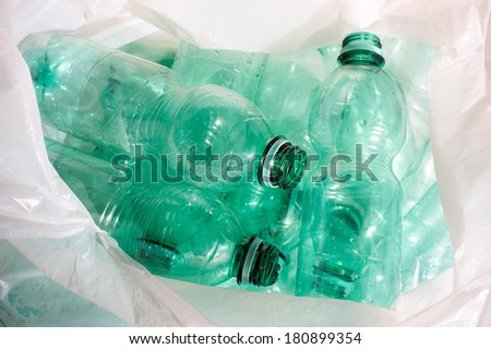 green plastic bottles sorted for recycling  - stock photo