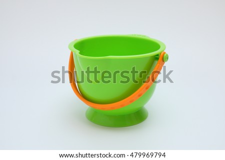 Green plastic bucket with handle up and down, isolated on white.