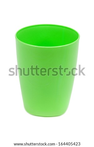 Green plastic cup on a white background
