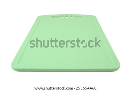 Green plastic cutting board isolated on white