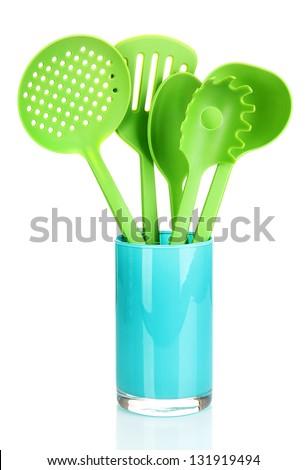 Green plastic kitchen utensil isolated on white - stock photo