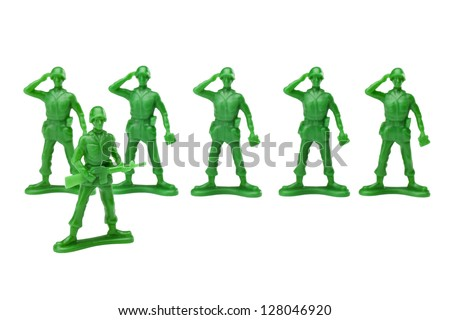 Green plastic military toys doing a salute to there captain over a white background - stock photo